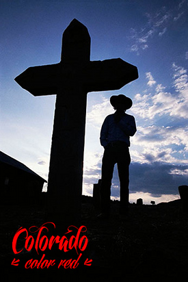 Silhouette of a Grave Marker and Cowboy